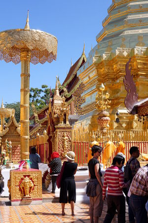 flocking: CHIANG MAI, THAILAND - February 03, 2014: A crowd of tourists and belivers flocking and praying at Doi Suthep temple in Chiang mai, Thailand. Editorial