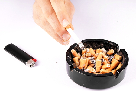 ashtray: Cigarette and ashtray
