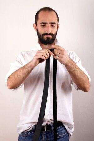 doing: Man doing his tie