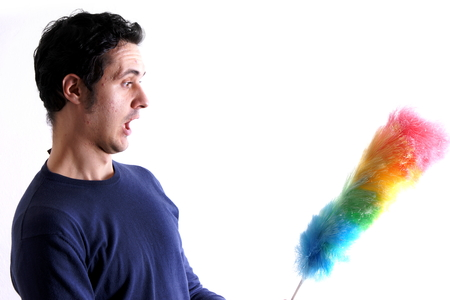 duster: Man with feather duster Stock Photo