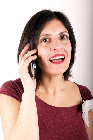 lady on phone: Lady with mobile phone Stock Photo