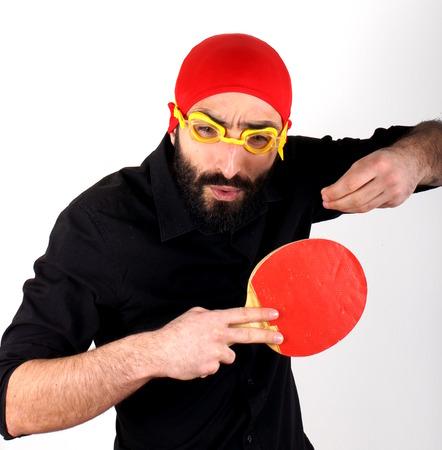 swimming cap: Man playing tennis racket wearing swimming cap Stock Photo