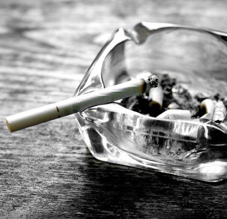 Cigarette and ashtray photo
