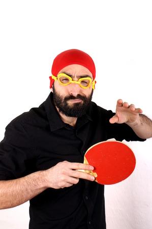 swimming cap: Man playing table tennis wearing swimming cap