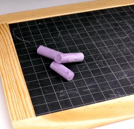 chalks: Blackboard and Coloured Chalks Stock Photo