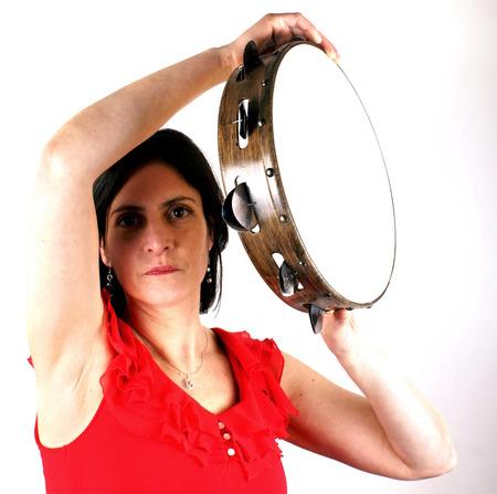 pandero: Mujer con pandereta Foto de archivo