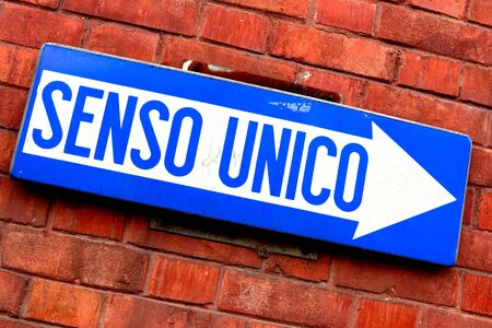 one way sign: Detail of an italian one way sign Stock Photo