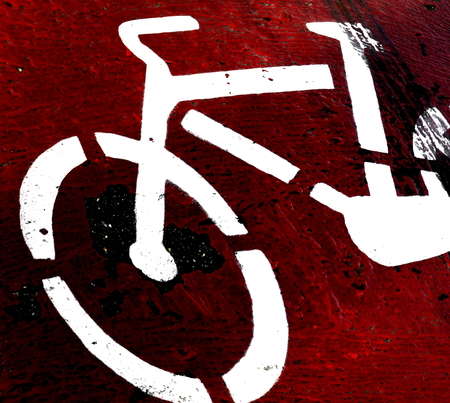 Close up of a red bike path photo
