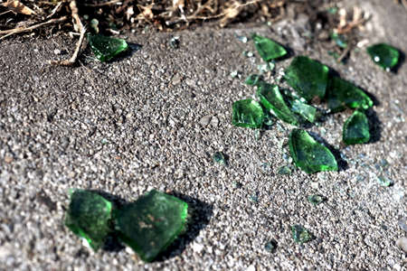 shards: Shards of green glass on the road