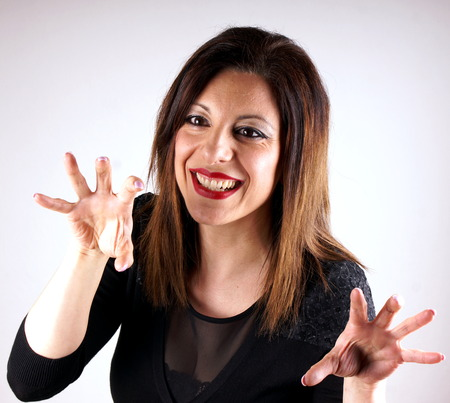 joking: Studio shot of a joking lady in black dress Stock Photo