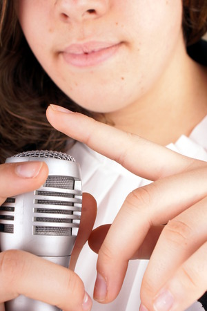 make public: Close up of fingers check a microphone