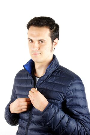 anorak: Studio shot of a young man with blue anorak