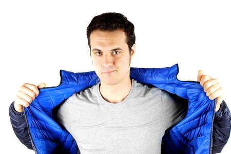 Anorak: Studioaufnahme eines jungen Mannes mit blauen Anorak Lizenzfreie Bilder