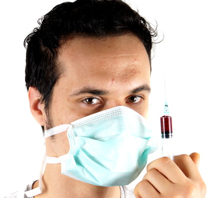 surgical mask: Studio shot of a young man with surgical mask Stock Photo