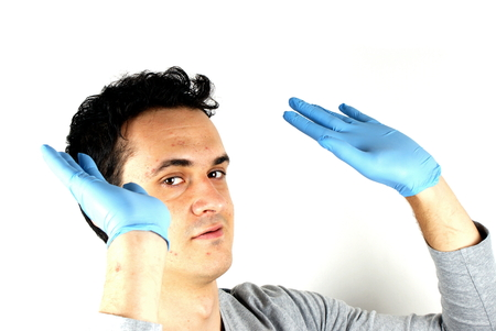 surgical gloves: Studio shot of a young man with surgical gloves