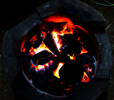 firebox: Close up of a burning traditional Thai brazier