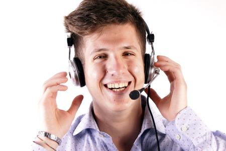 background skype: Studio shot of a young man with headphones Stock Photo