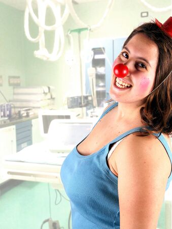 clown nose: Portrait of a young woman doing clown therapy Stock Photo