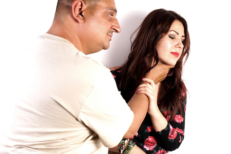 hurting: Studio shot of a man hurting a young lady