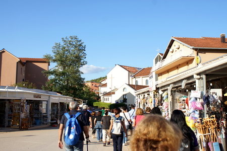 just arrived: Medjugorje, Citluk, Bosnia and Herzegovina - August 18, 2015: Pilgrims just arrived with bus pass in front of shops of religious items on the slopes of Mount Podbrdo in Medjugorje Editorial