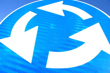 circle arrows: Close up of colorful traffic street signs Stock Photo