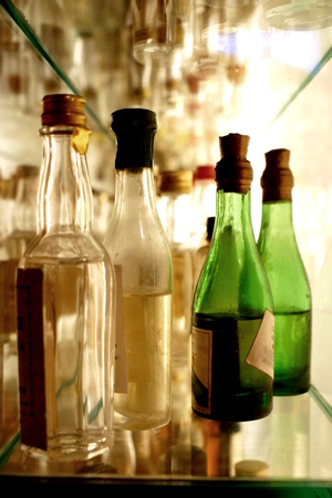 grappa: Collection of grappa bottles on shelf Stock Photo
