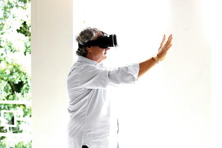 viewer: Man wearing a virtual reality viewer Stock Photo