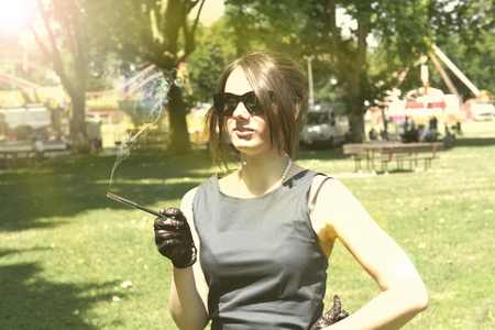 Picture of a smocking lady in the park