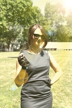 smocking: Picture of a smocking lady in the park