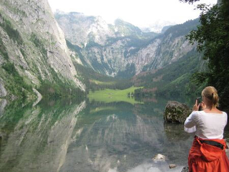 this picture shows a female photographer taking at the Konigssee in Germany. Stock Photo - 5583299