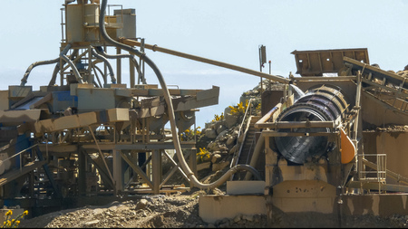 machinery at the ross open-cut gold mine in new zealand processes alluvial gravel for gold Stock Photo
