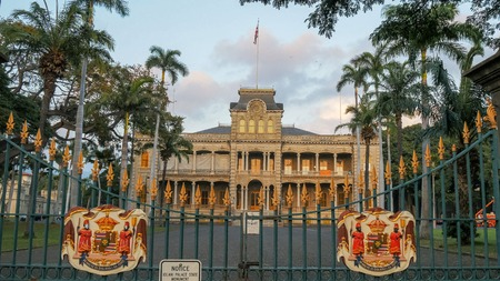 the front gates of iolani palace in honolulu, the only royal palace in the united states