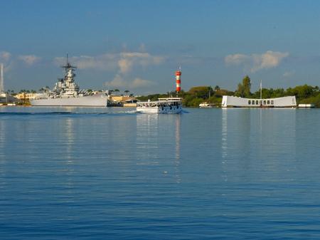 a boat takes visitors to the uss arizona memorial at pearl harbor Stock Photo