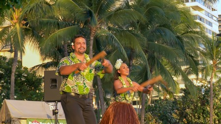 hula dancers with puili at waikiki in hawaii