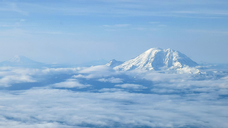 the aerial view of mount rainier, mount adams and mt st helens near seattle