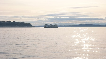 high key shot of a puget sound ferry approaching seattle