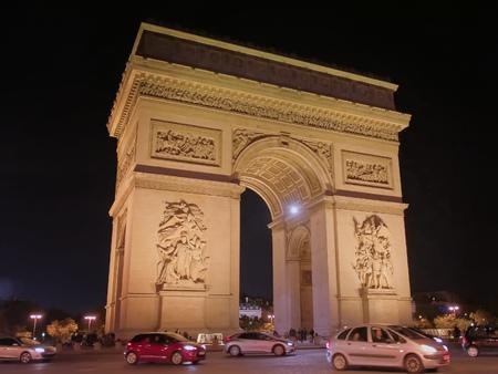 nighttime close up view of the arc de triomphe de letoile, paris