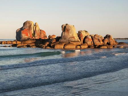 sunset at picnic rocks in tasmania, australia