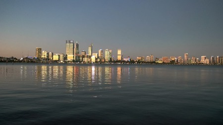 sunset wide shot of the city of perth and the swan river from south perth esplanade