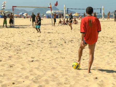 RIO DE JANEIRO, BRAZIL- 25,MAY, 2016: free kick in a beach soccer game on copacabana beach in rio Editorial