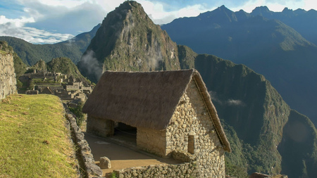 high angle view of a restored hut at machu picchu on a sunny morning