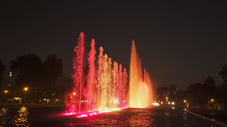 red lighting on the magic water circuit fountain in lima Stock Photo