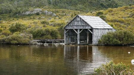 afternoon summer shot of the historic boat shed at dove lake in tasmania