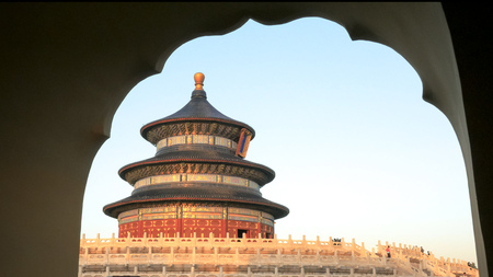 sunset view of the temple of heaven framed by an arch
