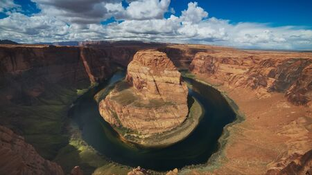 ultra wide shot of horseshoe bend with blue sky