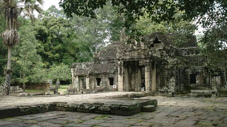 wide view of a courtyard in the ruins of banteay kdei temple at angkor wat