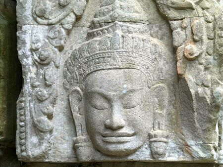 a carved face at preah khan temple