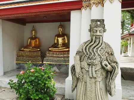 chinese and buddha statues at wat pho temple in bangkok 写真素材