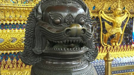 close up of a bronze chinese lion statue at wat phra kaew temple in bangkok