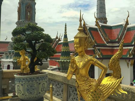 golden angel statues at wat phra kaew temple in bangkok